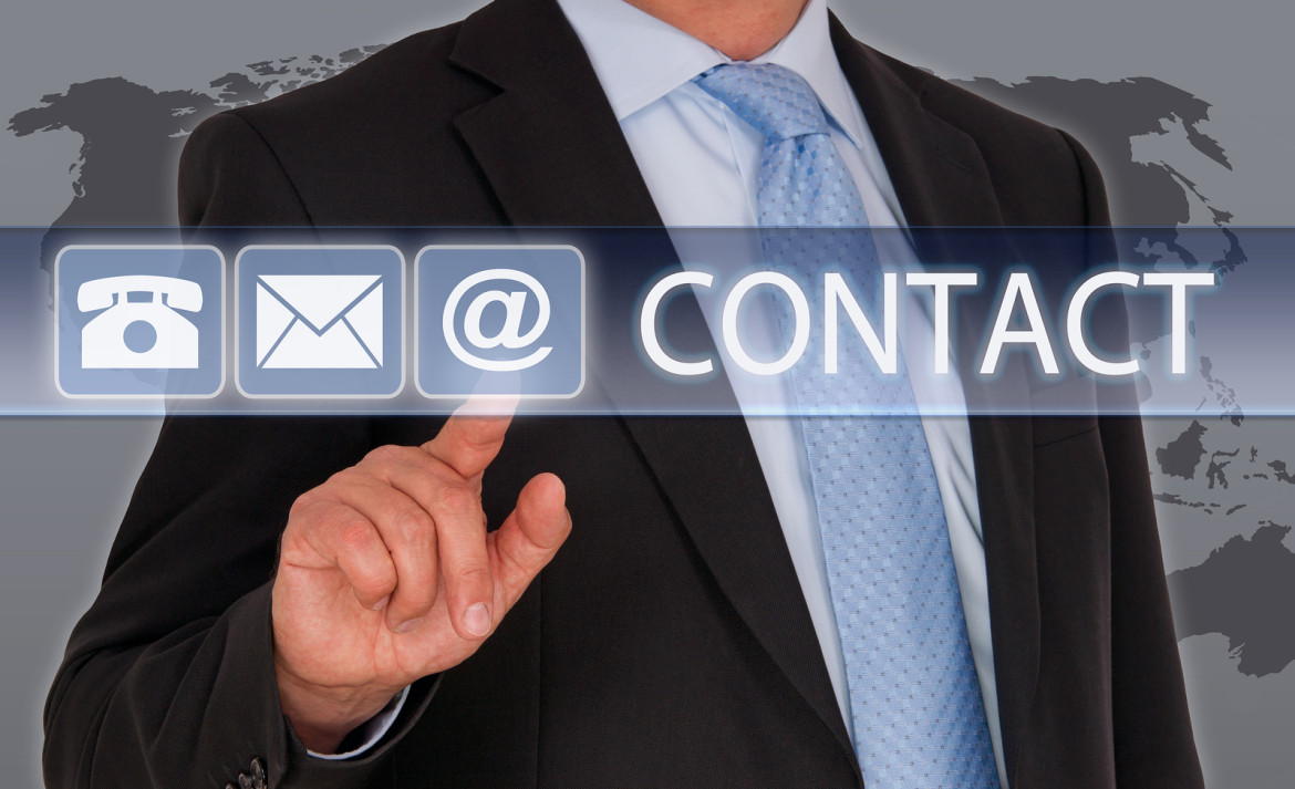 Contact us - Businessman touching screen with finger